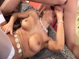mature regina acquires a load on her chest
