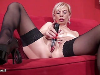 old blonde mother playing with toys