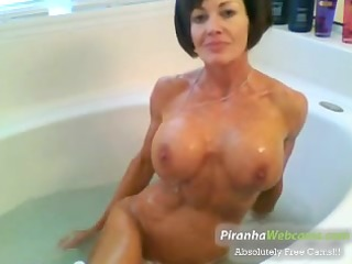 horniest and very muscled granny bathing ini the