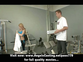 sexy golden-haired in the gym does oral-service