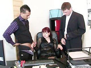 older office slut enjoys two cocks