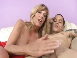 attractive older golden-haired plays with rigid