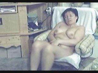 my mum home alone. hidden web camera in livingroom