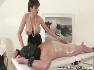 mistresse rubs her tractable knob during his