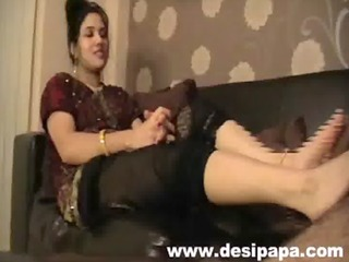 indian wife giving her hubby rod a foot massage