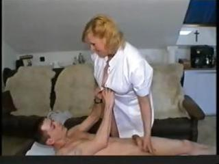 fat blonde granny nurse gives her patient head