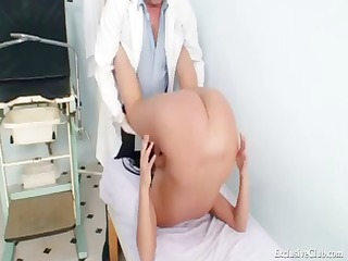 long-haired brunette hair babe visits the doctor