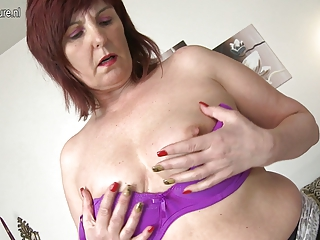 hot grandmother plays with her much loved toys