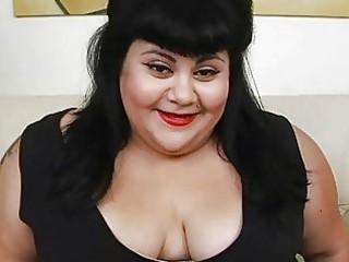 chunky black haired momma with tattoo masturbates