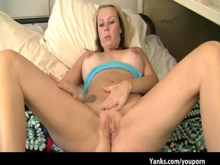 golden-haired milf fingers her drenched twat