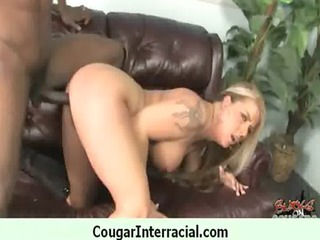 cougar with large tits seduces youthful dark guy