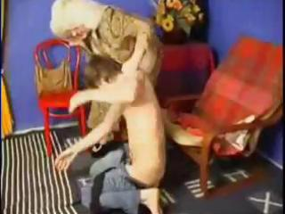 old mom spanks him and then copulates him