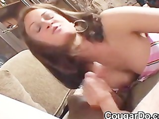 brunette chick gives a cook jerking