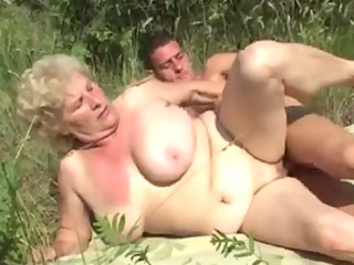german granny outdoor with young chap by troc