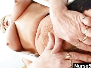 grandma in uniform widens golden-haired shaggy