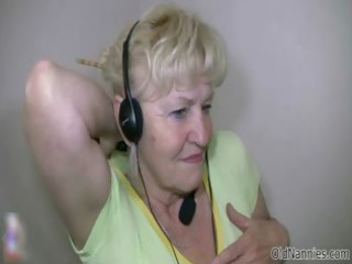 golden-haired granny with big tits dances naked