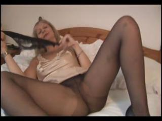 breasty mature blonde in hose takes them off and