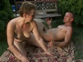 lusty bushy granny enjoying sex with a guy